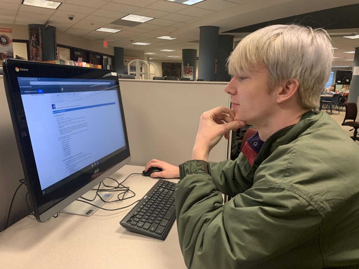 Senior Sam Sietsema looks over the sign up process for the step up program Feb 3. The deadline for signing up for Step Up is Feb . 10.