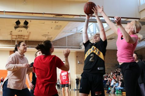 Senior Alex Riley takes a shot during the Sno Daze pep fest Feb. 14. Student Council announced the possibility of new mirrors in the bathrooms if students participated in dress codes.