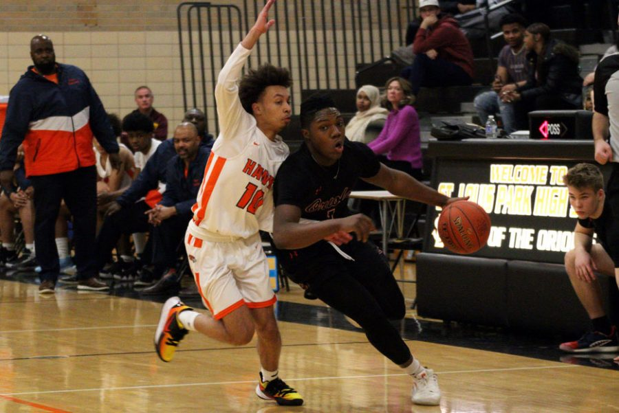 Sophomore Deontez Ross dribbles down the court Feb. 24. Park's next game will be against Armstong at 7 p.m. Feb. 26 at Robbinsdale Armstrong High School.