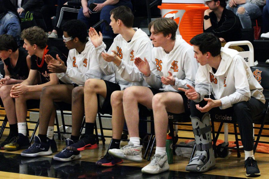 Junior varsity players cheer on their varsity teammates during the game. Park is currently ranked third in the Metro West Conference.