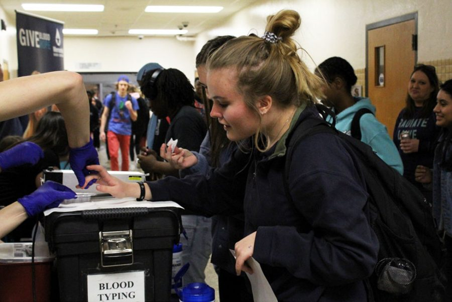 Junior Lydia Hammond gets her blood type taken during third lunch Feb. 28. Memorial Blood Drive will be hosting a blood drive hours 1-6 March 4 at Park.