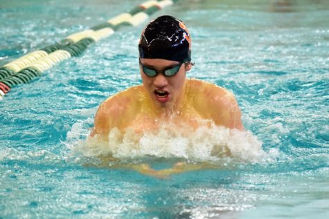 Junior Hayden Zheng swims the 100-yard breaststroke during Varsity Sections Feb 22. Zheng qualified for State Feb. 29 at the University of Minnesota.