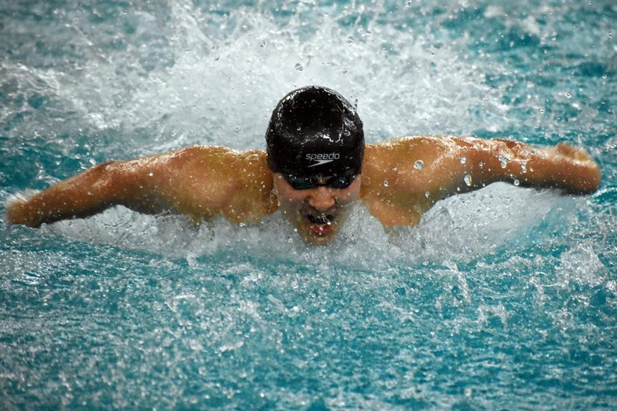 Sophomore+Hiro+Mckee+swims+the+100-yard+butterfly+during+the+Varsity+Sections+meet+Feb+20.+The+second+day+of+the+meet+will+be+Feb.+22+at+the+Art+Downey+Aquatic+Center.