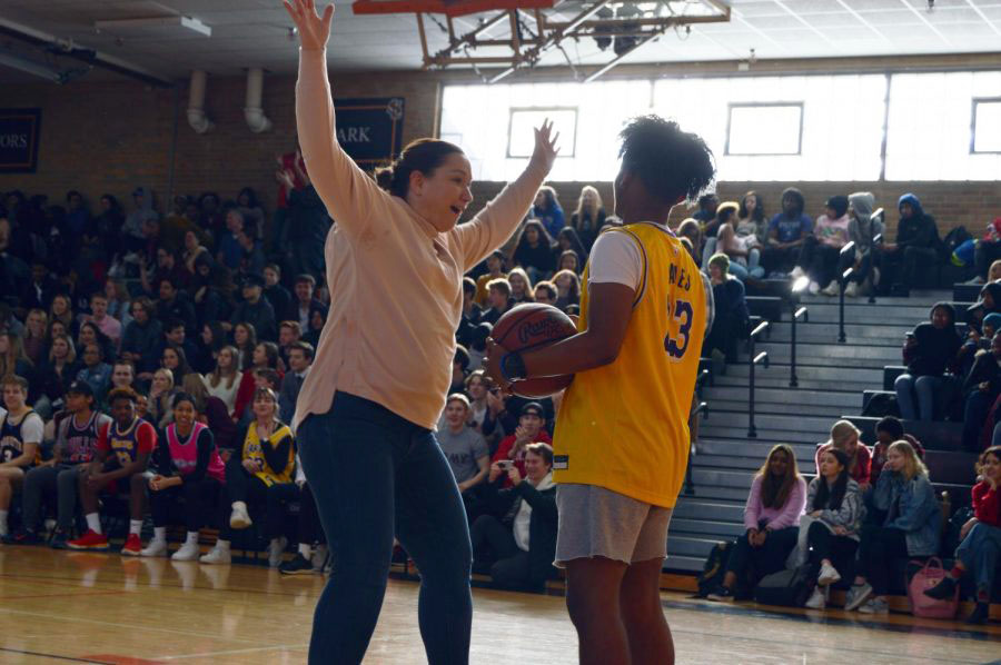 Assistant principal Jessica Busse guards junior Mekhi Scurlock. Scurlock successfully made it around Busse's defense.