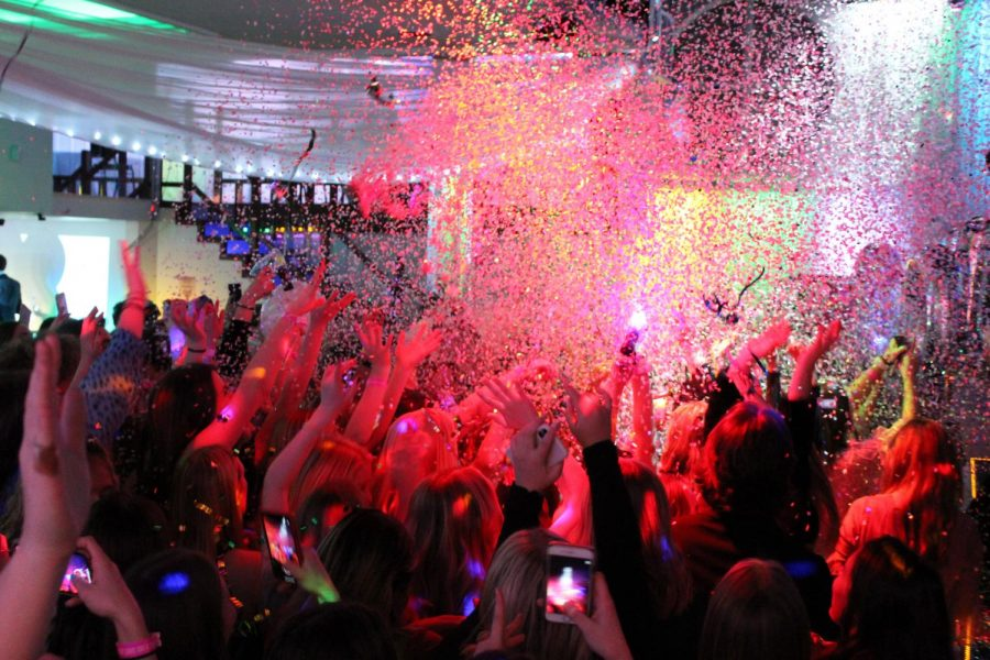 Confetti is thrown into the crowd of excited participants during the dance party portion of the gala.