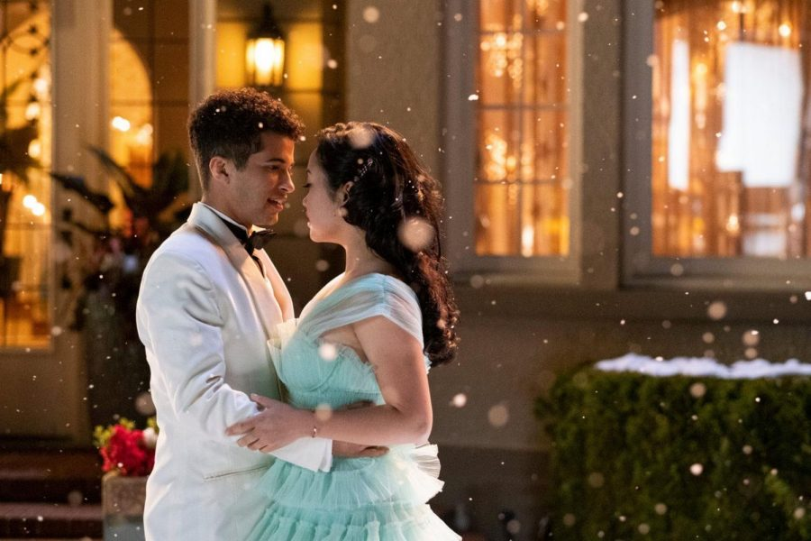 Fair use from Netflix: John Ambrose (Jordan Fisher) holds Lara Jean Covey (Lana Condor) as they greet each other before the dance.
