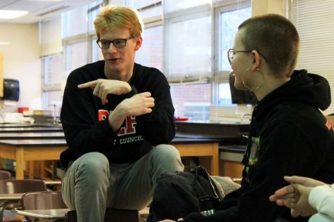 Seniors Patrick Djerf and Maddie Lind discuss the gender inequality in the University of Minnesota Talented Youth Mathematics Program during the Feminism club meeting Feb. 13. The club discussed how women are outnumbered in high academic classes and in STEM.