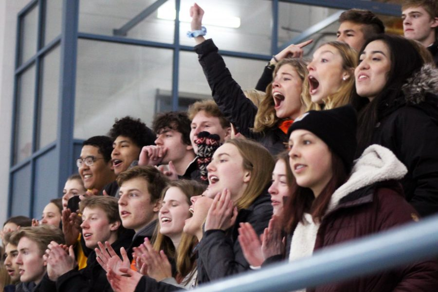 The student section cheers on the boys' hockey team as they regain the puck. Park and Benilde-St. Margaret's are currently the winningest teams in the Metro West Conference with a total of 15 wins each.