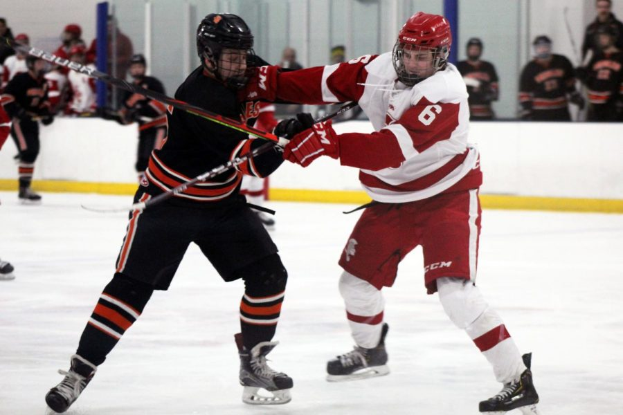 Benilde-St. Margaret's sophomore Ben Thompson shoves junior McCabe Dvorak Feb. 13. Park lost 0-4.