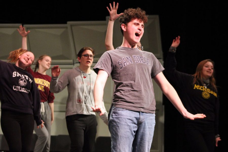 Junior Leo Dworsky playing Corny Collins sings while rehearsing the song hairspray for the choir musical Feb. 13.
