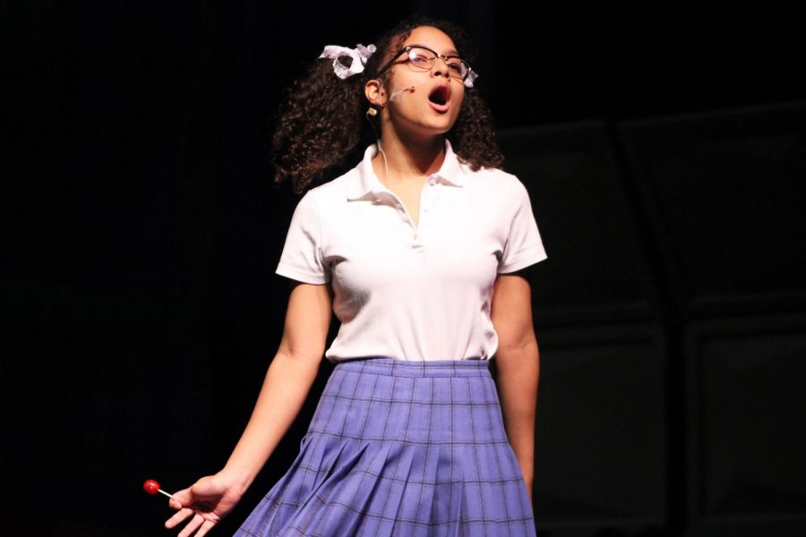 Sophomore Jada Mclemore playing Penny Pingelton sings the song Big Dollhouse during choir practice the week before the first performance Feb. 20.