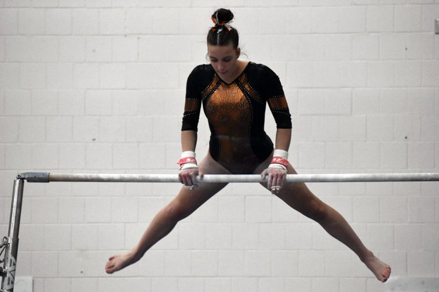 Junior Marissa Boettcher preform her bar routine at Varsity Sections Feb. 15. Park placed sixth overall in the meet.