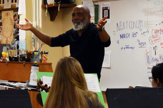 Conductor William Eddins talks to orchestra Feb. 28. Eddins was invited in for Black History Month to talk about minorities in classical music.