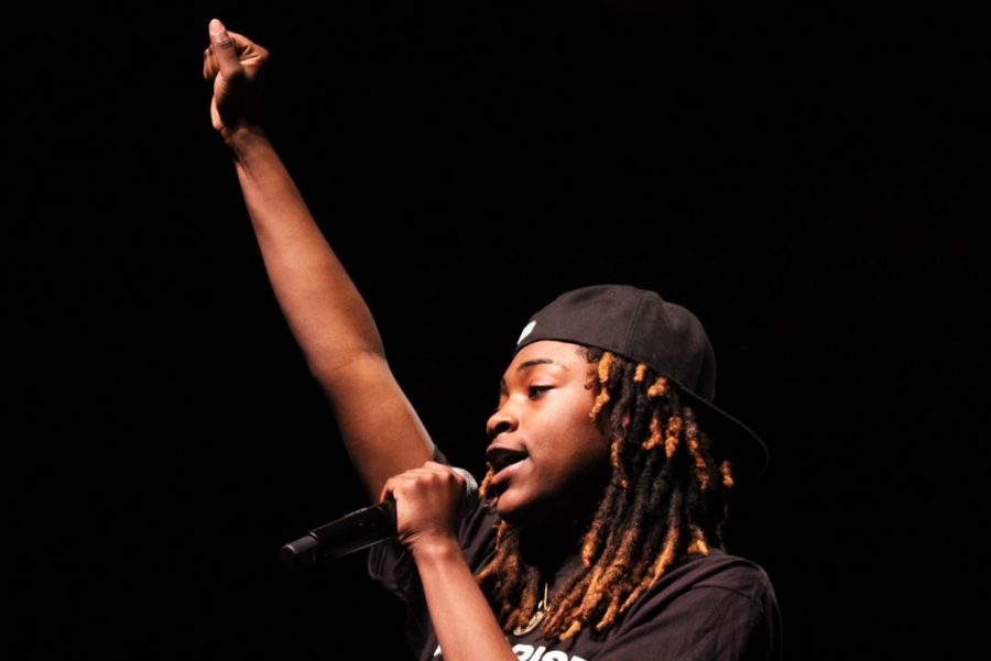 Senior Ky'Areia Malone raises her fist at the end of her spoken word presentation Feb. 28. The Black History Month presentation was performed during fourth and sixth hour.
