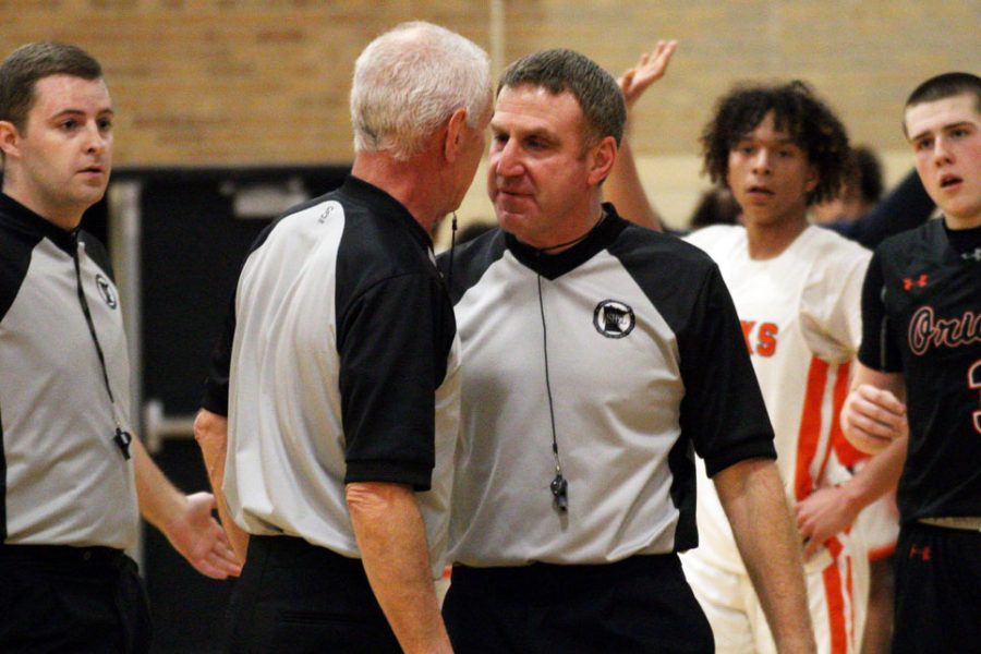 Referees of the St. Louis Park v. Cooper game argue over an intense call during the final minutes of the game Feb. 24. The final call was made in favor of Cooper.