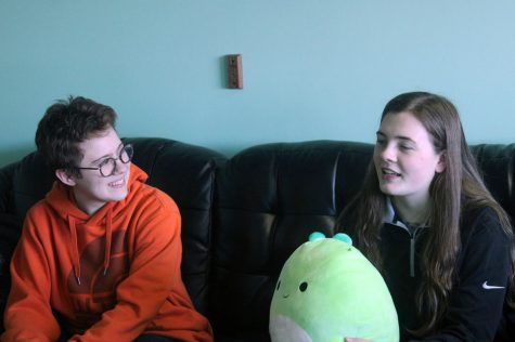 Juniors Zoe Frank and Keely Bernstein discuss the new Roots and Shoots video Feb. 24. The club wants to debut the video about recycling in the upcoming months.