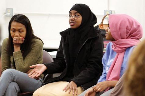 Director of assessment, evaluation and research Silvy Un Lafayette and junior Helen Tefera listen to junior Iqra Abdi share her opinion during the SOAR meeting Feb. 24. SOAR met with the superintendent and his administration to discuss issues surrounding race in the district as a whole.