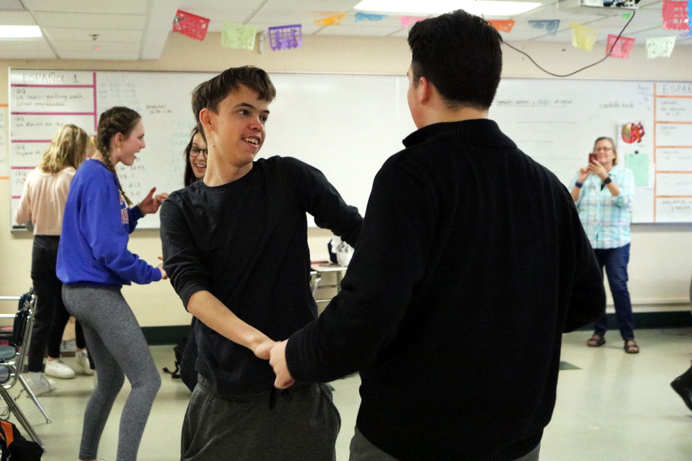 Juniors Isaac Scott and Justin Colon dance together at the Spanish club Feb. 12th. The meeting was focused around different Latin American music and dancing.