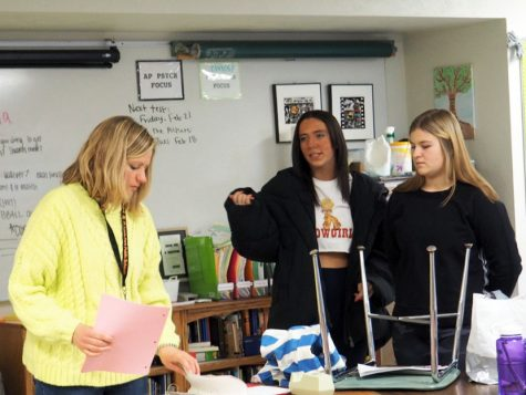 Seniors and Student Council co-presidents Anna Wert and Anna Nicholls discuss Sno Daze plans with adviser Sarah Lindenburg. Student Council is in charge of organizing Sno Daze week activities and decorating for the dance.