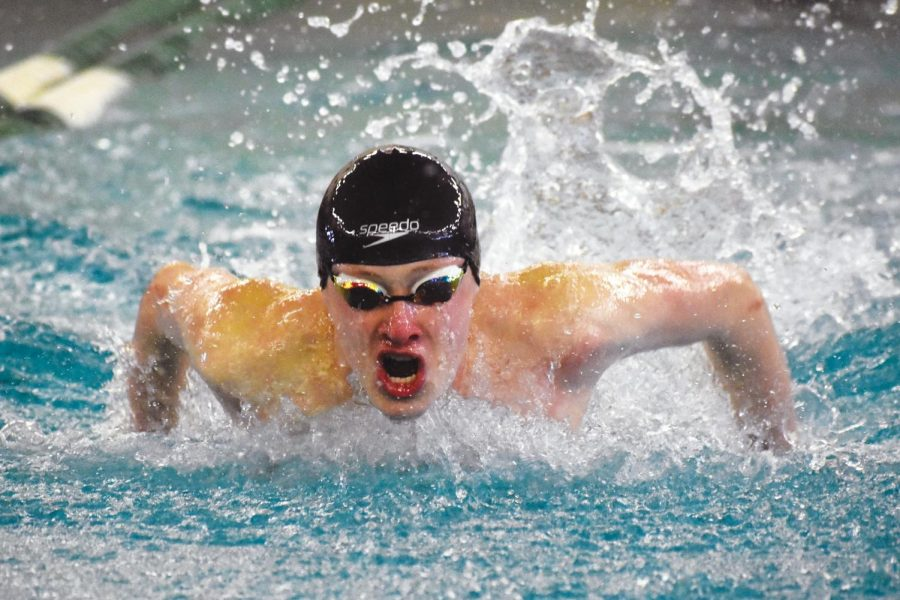 Junior Zach Affeldt swims the 100-yard fly at Sections Feb. 22. Affeldt finished fifth with a time of 53.22 seconds. Affeldt will swim the 50-yard fly for the medley relay at State.