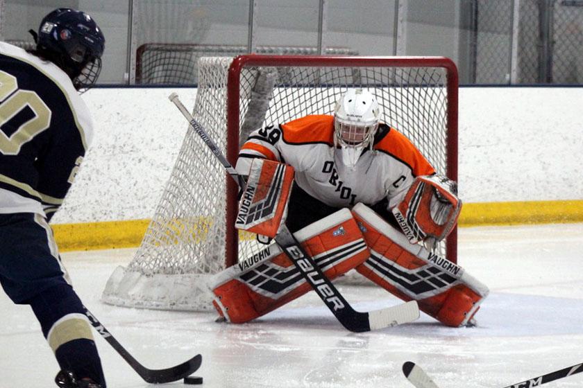 Senior William Pinney prepares to block a shot Feb. 6. Pinney will be leaving March 7 to play junior hockey in Alaska.