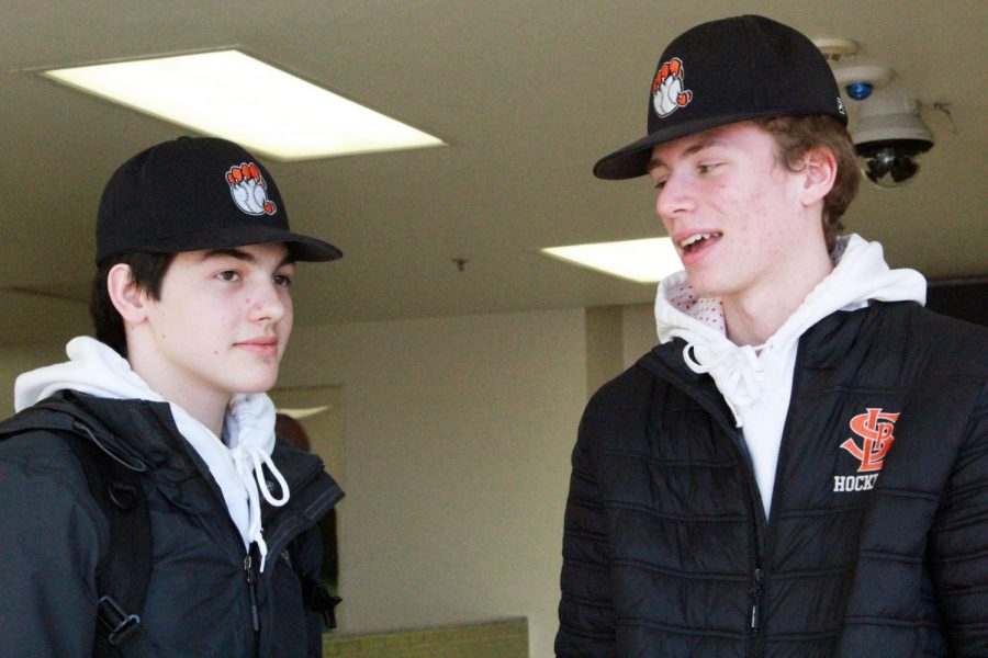 Juniors Eastyn Samoy and Max Wyatt wear their baseball and hockey apparel March 13. Apparel items for sports have been priced high recently, causing athletes to turn away from purchasing sports apparel.