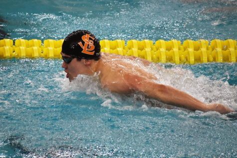 Junior Hayden Zheng swims the 200-yard individual medley during the boys