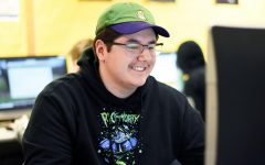 Junior Angel Diaz smiles during the eSports meeting March 5. According to coach Jake Utities, the meeting was in preparation for the eSports spring season.