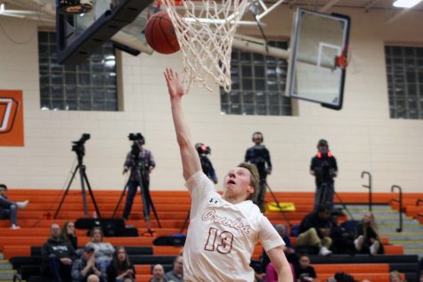 Senior Erik Piehl goes up for a layup against Robbinsdale Cooper March 6. During their Sections game Park fell to Cooper ending its season.