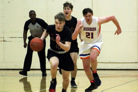 Sophomore Will Dvorak dribbles down court toward the basket. Park won 73-70 against Washburn. The team will play its second Section game 7 p.m. March 6 against Robbinsdale Cooper.
