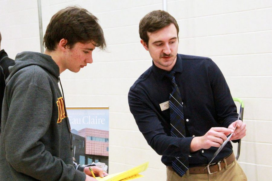 Sophomore Danny Shope gathers information from a representative of the University of Wisconsin-Eau Claire March 11. The college fair allowed for students in all grades to visit information booths from participating colleges and learn about their post-secondary options.