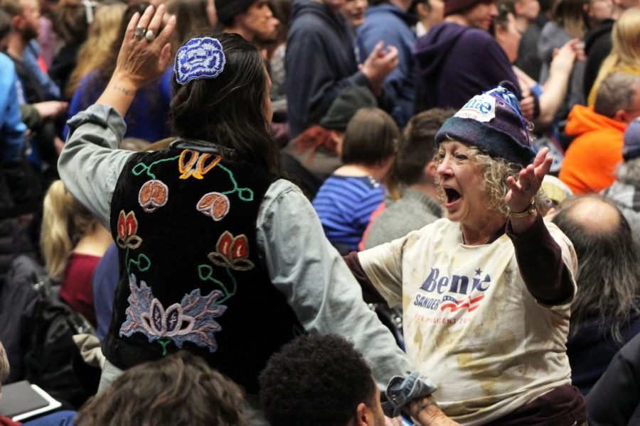 Two rally attendees dance together during one of the musical performances before Sanders spoke. Several speakers and performers took the stage during the evening, including Minnesota Rep. Ilhan Omar and Nathaniel Rateliff & The Night Sweats.