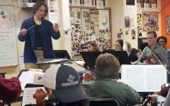 Used with permission from Kou Lee.  Conductor and composer Erika Svanoe conducts the 4th hour orchestra class March 9. Svanoe was invited to speak and practice with the orchestra in honor of Women's History Month.