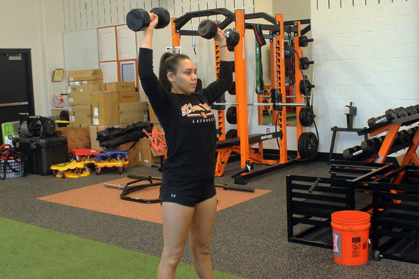 Junior Jairelyz Lopez-Barrera works out to prepare for the upcoming lacrosse season. The girls' first strength and conditioning session for lacrosse was March 7.