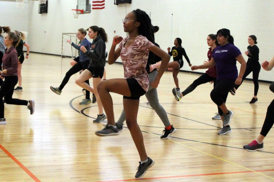 Junior Jamillah Berry warms up during track practice March 11. The track team began practices in preparation for their season which started March 9.