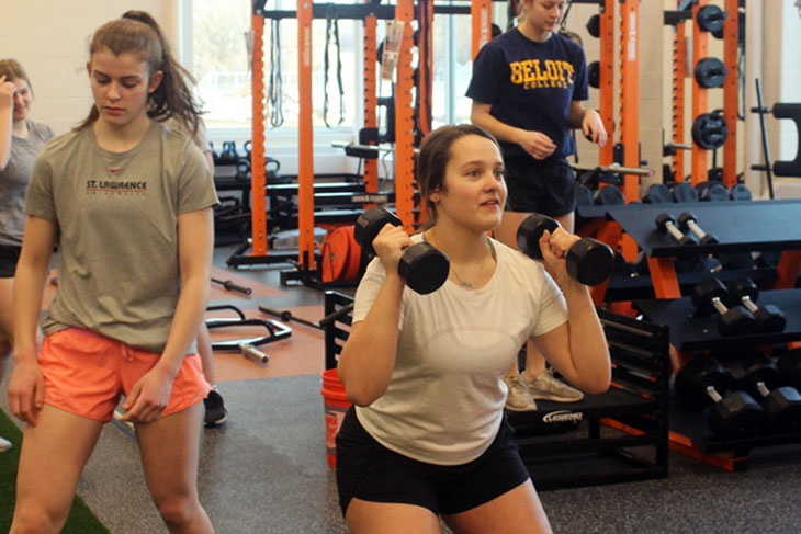 Captain Sarah Mccallon lifts weights in preparation for the upcoming girls' lacrosse season. The season officially starts April 6.