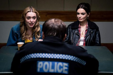 Fair use from Netflix: Aimme Gibbs (Aimme Lou Wood) and Maeve Wiley (Emma Mackey) talking to the police about sexual misconduct. Season 2 of