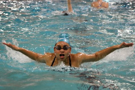 Junior Bella Steward practices the butterfly stroke March 12. This was the first sychro practice held since the new team captains had been announced March 11.
