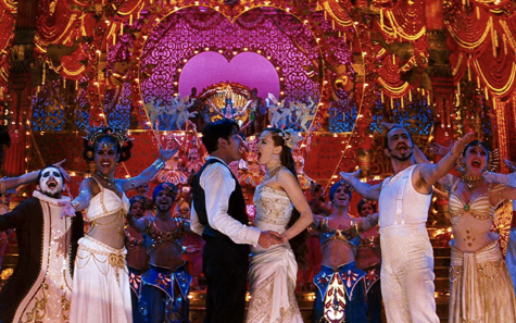 "Fair use from 20th Century Fox. Christian (Ewan McGregor) and Satine (Nicole Kidman) sing their love for one another amidst an extravagant musical number. ""Moulin Rouge!"" (2001) tells an updated version of a 100-year-old story."