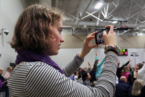 Senior and Editor-in-Chief of Echo Marta Hill films protestors at the presidential rally of Sen. Amy Klobuchar March 1 at Park. Hill was named a runner-up in JEA's 2020 National High School Journalist of the Year competition April 18.