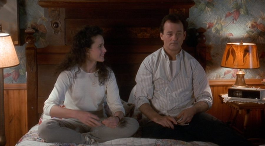 Fair use from Sony Pictures Entertainment. Phil Connors (Bill Murray) sits next to Rita Hanson (Andie MacDowell) on his bed as she wonders what will happen to them the next day. Earlier in the day, Phil tells Rita that he's lived this day already and she wants to understand why it only effects Phil.