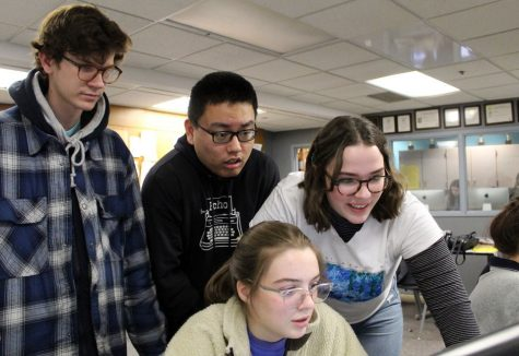 Juniors Ben Sanford and Sophie Livingston and seniors Tennam Gyaldatsang and Maggie Klaers edit a page during Echo's late night Feb. 25. Echo was recently awarded fifth in the Online Best of Show and Print Tabloid Best of Show categories, as well as named one of 16 to win the National Scholastic Press Association's Online Pacemaker.