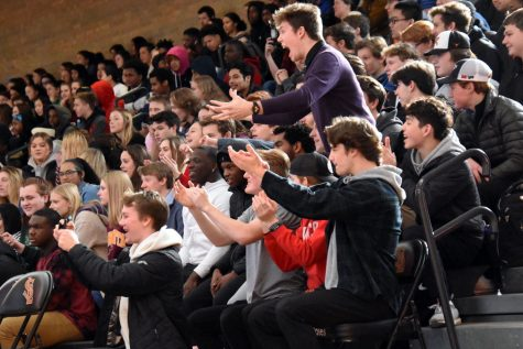 The senior section cheers during the pep fest Feb. 14. According to senior Anna Nicholls, seniors may be able to have their last school dance in the summer, because the in-person Prom April 18 was cancelled due to COVID-19.