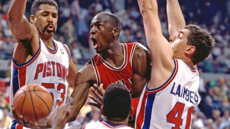 Fair use from ESPN. Michael Jordan of the Chicago Bulls goes up for a layup against James Edwards and Bill Laimbeer of the Detroit Pistons. The Pistons eliminated Jordan and the Bulls from the playoffs three seasons in a row before Jordan captured his first title.