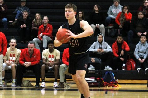 Senior Aaron Ellingson passes the ball in a game Dec. 10 against Henry Sibley. Ellingson was named one of 28 recipients of the All-American Award.