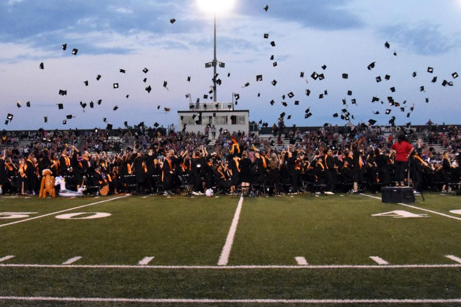 The+class+of+2019+throws+its+caps+in+the+air+after+graduation+June+6.+Minnesota+Department+of+Health+and+Department+of+Education+announced+May+8+that+large+scale+in-person+graduations+are+prohibited+for+the+class+of+2020+due+to+the+COVID-19+pandemic.