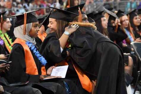 Park alum Natalia Caraballo gives her classmate a hug during Graduation June 6, 2019. After Gov. Tim Walz banned all large in-person commencement ceremonies for the class of 2020 in light of the COVID-19 pandemic May 8, Park had to reevaluate its Graduation plan.