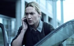 Dr. Erin Mears (Kate Winslet) talks on the phone with someone amidst her research to understand the source of the flu-like disease spreading throughout the world. The movie