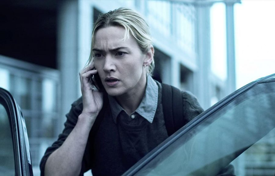 "Dr. Erin Mears (Kate Winslet) talks on the phone with someone amidst her research to understand the source of the flu-like disease spreading throughout the world. The movie ""Contagion"" is available on Amazon Prime and Hulu."