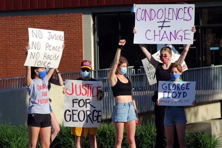 Park students including seniors Hattie Kugler and Ella Thomas chant in front of the the St. Louis Park City Hall building. A group of Park students and alumni separated from the main memorial to go to City Hall toward the end of the event.